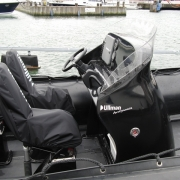 Aerodynamic boat console with windshield